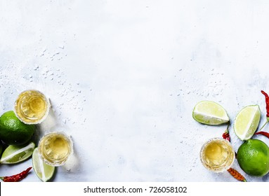 Tequila with lime and salt. drink background top view