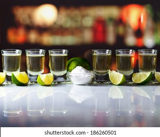 tequila , lime and salt on  table in bar