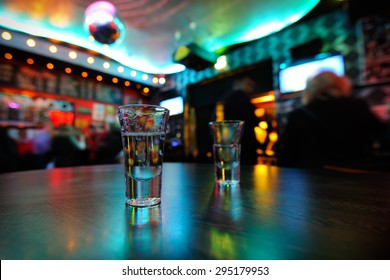 Tequila in shot glasses on the table in a nightclub. Selective Focus
