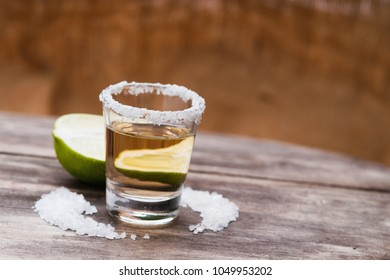 Tequila shot with lime fruit and salt