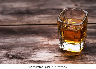 Tequila shot on a wooden background