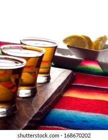Tequila shots with lemon and salt. Shallow focus on lemons.