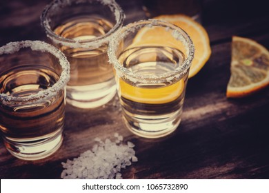 Tequila shots with lime fruit and salt