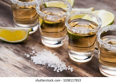 Tequila shots with lime fruits and salt