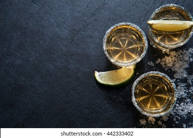 Tequila shots with lime slice and salt, top view