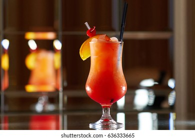 Tequila sunrise Cocktail on a mirror background