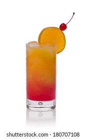 Tequila sunrise in a glass with a slice of orange and cherry against a white background.