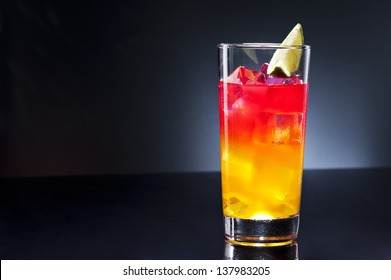 Tequila sunrise, the story about the drink says that it was first served in Cancun and Acapulco in the 1950's. After a brief surge in 70's discos, it lost much of its glory.