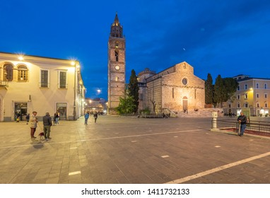 Teramo, Italy - 18 May 2019 - The elegant historical center, with street and stone church, of this hill and province city in Abruzzo region.