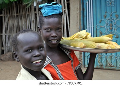 TEREKEKA - JUNE 11: Unidentified children selling cooked corn in Terekeka, South Sudan, on June 11, 2011. World Day Against Child Labour, launched by ILO, was observed on June 12, 2011.
