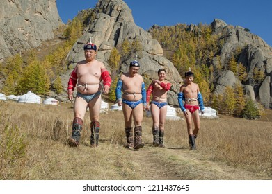 TERELJ,  GORKHI-TERELJ NATIONAL PARK , MONGOLIA -  28 OCTOBER 2014 : a group of mongolian wrestlers in their colorful gear on the way to the  matches