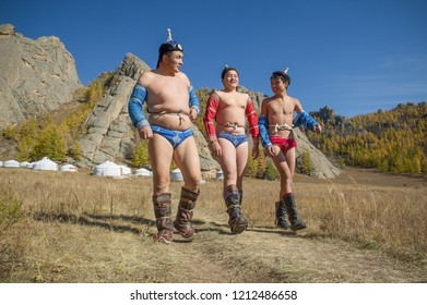 TERELJ,  GORKHI-TERELJ NATIONAL PARK , MONGOLIA -  28 OCTOBER 2014 : three mongolian wrestlers on the way to the  ring