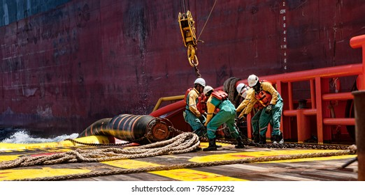 TERENGGANU, MALAYSIA - 10 MARCH 2015, offshore marine crew connecting cargo hose for crude oil transfer
