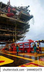 TERENGGANU, MALAYSIA - 20 JUNE 2018, marine crew transfer oil platform personnel using safety basket by crane