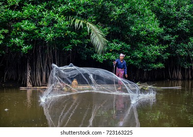 Terengganu Malaysia - 27th September 2017 : old fisherman at the river with a brittle raft