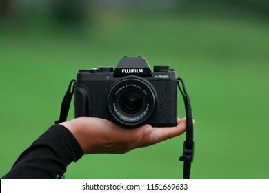 Terengganu, Malaysia - 7th August 2018: The Fujifilm X-T100 mirrorless digital camera. The Fujifilm X-T100 is one of Fujifilm's X series, announced on May 24, 2018.