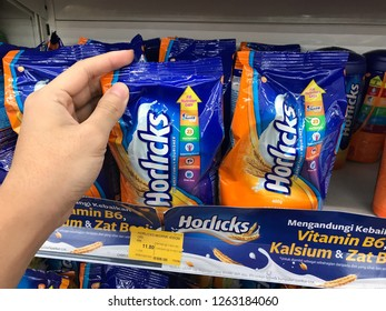 TERENGGANU, MALAYSIA - Dec 19, 2018 : Hand pickup a new design packed of Horlicks, a healthy malted milk drinks for sell in the supermarket.