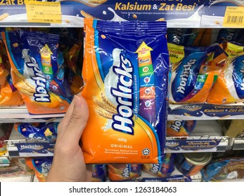 TERENGGANU, MALAYSIA - Dec 19, 2018 : Hand holding a pack of Horlicks, a healthy malted milk drinks for sell in the supermarket.