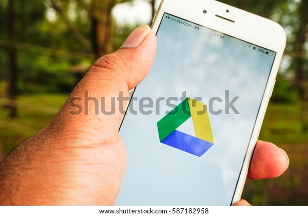 Terengganu, Malaysia, February 2017: A man holding an Iphone shows the Google Drive icon. Iphone is the most popular smartphone.