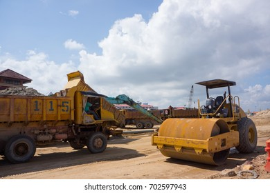 TERENGGANU, MALAYSIA - JANUARY 7, 2016 : Heavy Machinery Doing Earth Works By The River Of Terengganu With Blue Sky Background