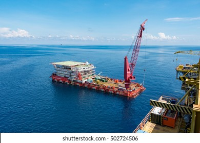 TERENGGANU, MALAYSIA - July 18, 2016 - A typical accommodation and work barge on a standby position near an oil/gas rig/platform.