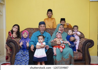 TERENGGANU, MALAYSIA - JUN 2018: Picture of family portrait at Islamic festival, grandson with grandma and grandfather.
