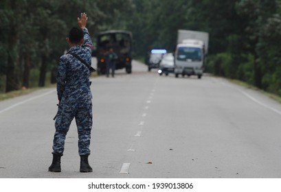 TERENGGANU, MALAYSIA June 16, 2017 : Officer rising hand to control traffic near the spot where a missing Royal Malaysian Air Force (RMAF), Hawk 108 fighter jet has crashed.