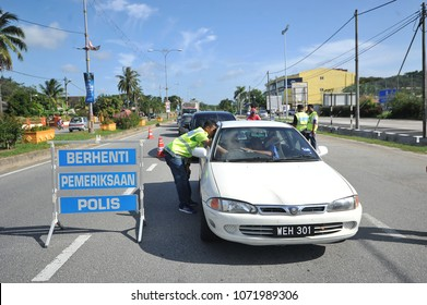 TERENGGANU, MALAYSIA : MARCH 5, 2018 - The police made a check on roadblocks when there was a crime in the area, the record was taken during roadblocks in the Marang district.
