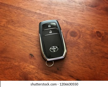 TERENGGANU, MALAYSIA - Oct 18, 2018 : Keyless remote for car or vehicle with Toyota logo on it isolated on wooden background with copy space for text.
