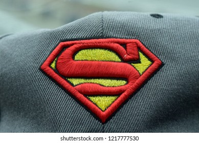Terengganu, Malaysia   - October 12, 2018 : Superman baseball caps (Hat ) with detail embroidery and colorful display in the shop.