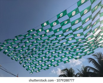 Terengganu, Malaysia-April 23, 2018 : Huge local party flags stiched by a local political party members. Malaysia 14th general election will be held on May 9, 2018.