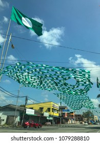 Terengganu, Malaysia-April 23, 2018 : Huge local party flags (top) stiched by a local political party members. Malaysia 14th general election will be held on May 9, 2018.