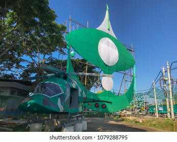Terengganu, Malaysia-April 29, 2018 : Large traditional kite and a mock up helicopter built by a local political party members. Malaysia 14th general election will be held on May 9, 2018.