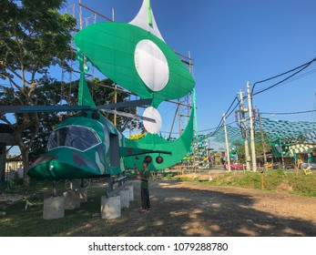 Terengganu, Malaysia-April 29, 2018 : An unidentified boy takes photo of a mock up helicopter built by a local political party members. Malaysia 14th general election will be held on May 9, 2018.