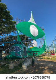 Terengganu, Malaysia-April 29, 2018 : An unidentified boy walks on by a mock up helicopter built by a local political party members. Malaysia 14th general election will be held on May 9, 2018.