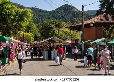 TERESOPOLIS, RIO DE JANEIRO - BRAZIL: AUG 15, 2020: People walking and browsing items for sale in Alto Fair, a public market located in the surroundings of Higino da Silveira square, Alto district.