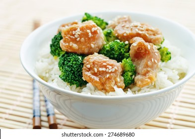 teriyaki chicken and broccoli stir fry with rice. the toning. selective focus