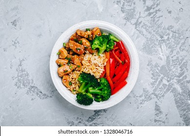 Teriyaki Chicken buddha bowl lunch with rice, broccoli, carrots and red bell pepper