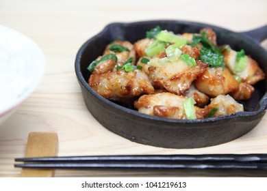 Teriyaki chicken with green onions in skillet
