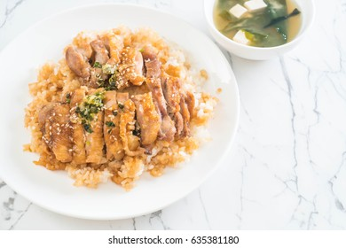 teriyaki chicken on topped rice with miso soup - japanese food style