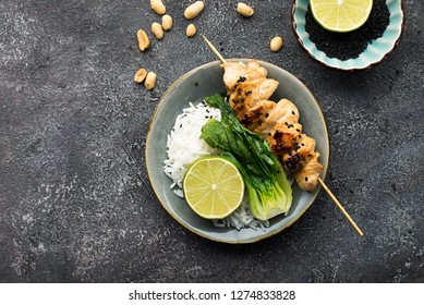 Teriyaki chicken skewers, cabbage bok choy, rice buddha bowl. Concept of healthy eating. Top View.
