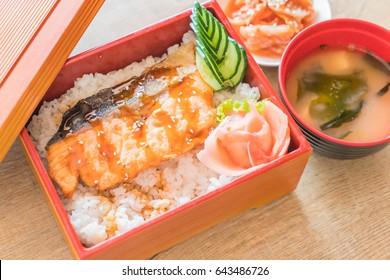 teriyaki salmon on top rice in box set - japanese food style
