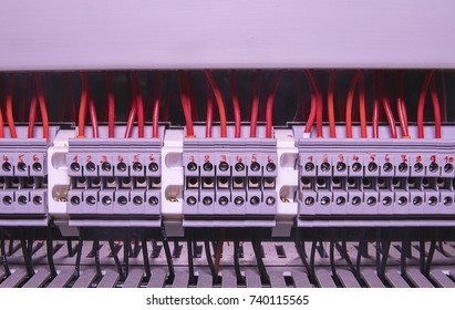Terminal block for industrial electronic. Terminal block. Industrial power case. Red and black wires