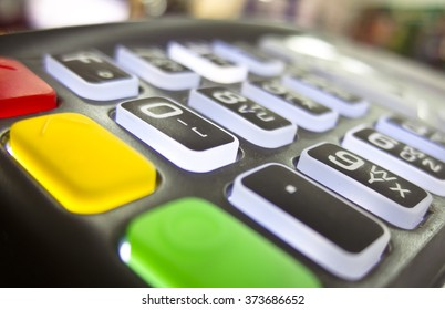 The terminal for cashless payment money bank credit card with glowing buttons and bright multicolored cancel buttons