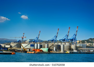 terminal cranes and forklifts in Genova port, Italy
