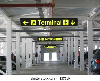 Terminal signs at the airport's parking