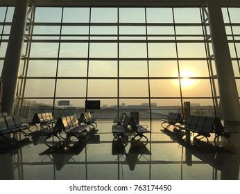 Terminal waiting seats with sunset