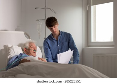 Terminally ill man reading the testament to his grandson