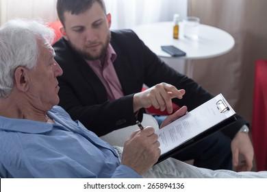 Terminally ill senior signing last will and testament