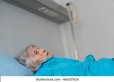 Terminally ill senior woman. Selective focus